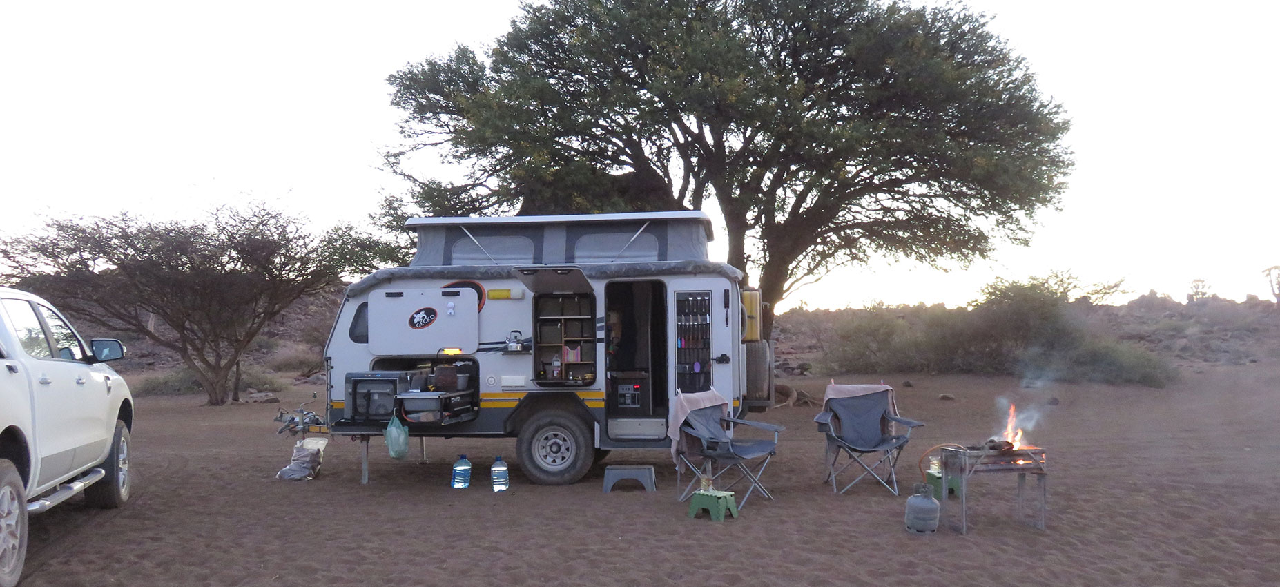 Offroad Caravan Under Tree